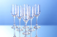 Few empty wine glasses on blue Royalty Free Stock Photo