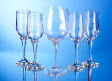 Few empty wine glasses on blue Stock Images
