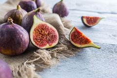 A few figs freely lying on old wooden table.  royalty free stock photography