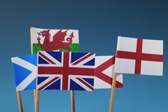 A few flag of states. Four members of united kingdom. Scotland, England, Wales, Nothern Ireland. Blue background stock image