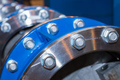 Few flanges with bolts and nuts Royalty Free Stock Photos