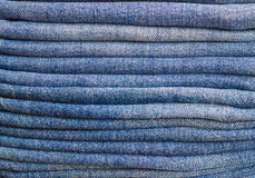A few folded jeans. Jeans stacked on top of each other Stock Photos