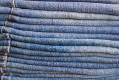 A few folded jeans. Jeans stacked on top of each other Royalty Free Stock Images