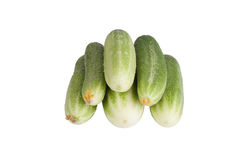 Few fresh cucumbers with flowers isolated on white background Royalty Free Stock Photo