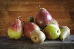 A few fresh pears. A pile of pears on a wooden table Stock Image