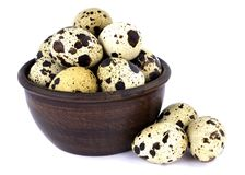 Quail eggs in a bowl isolated on white background. Few fresh quail eggs in a ceramic bowl isolated on white background Royalty Free Stock Photography