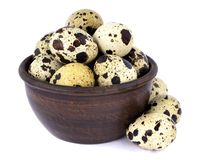 Quail eggs in a bowl isolated on white background. Few fresh quail eggs in a ceramic bowl isolated on white background Stock Photos