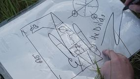 A few friends collected a homemade aircraft out of cardboard. Funny funny frames from the rest of friends stock video