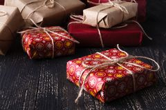 Few giftboxes on wooden table Royalty Free Stock Photo