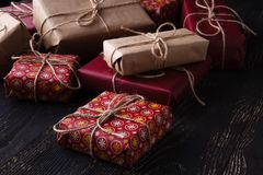 Few giftboxes on wooden table Royalty Free Stock Images