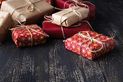 Few giftboxes on wooden table Stock Images