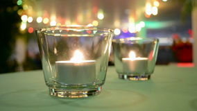 Few glass with candle fire inside, interior decoration, stock footage