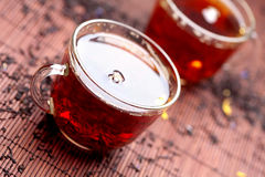 Few glass cups with black tea Royalty Free Stock Photo