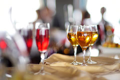 Few glasses of wine, champagne or another alcoholic beverage on a table Royalty Free Stock Photography