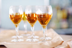 Few glasses of wine, champagne or another alcoholic beverage on a table Stock Photography