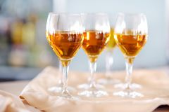 Few glasses of wine, champagne or another alcoholic beverage on a table. During party, wedding reception or festive event Stock Photo