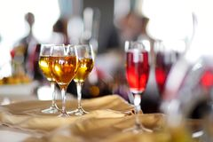 Few glasses of wine, champagne or another alcoholic beverage on a table. During party, wedding reception or festive event Royalty Free Stock Photography