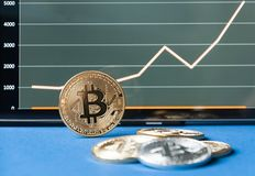 Two bitcoins  are lie on the planing. On the calendar are the last days of December 2017. The concept of crypto currencies Royalty Free Stock Photo