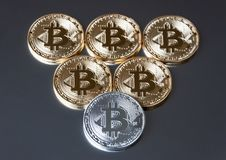 A few gold and silver coins bitcoin lie or stay on edge on a dark background. The concept of crypto currency. Stock Photography
