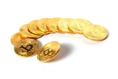 A few golden coins with the sign of bitcoin lie in a semicircle on a white background.  Stock Image