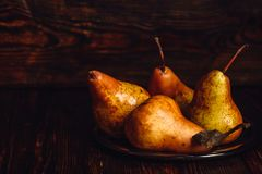 Few Golden Pears on Plate. Royalty Free Stock Photo