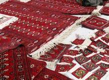 Few handmade carpets. Turkmenistan. Ashkhabad market Stock Photos