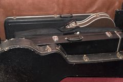 Hard Cases for guitars Are At The Wall royalty free stock photography