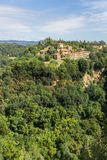 Few houses built on rock in Tuscany Italy with forest around Stock Photography