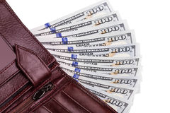 A few hundred dollar bills in a wallet Stock Photo