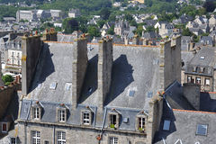A few imposing chimney-pots. A sequence of spectacular chimney-pots upon an house of the old part of dinan(britanny royalty free stock images