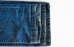 A few jeans close-up. A few shabby trousers stacked on top of each other Royalty Free Stock Photos