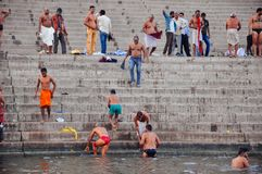Locals having a bath in Varanasi, India. A few locals having a bath in the Ganges River in Varanasi, India stock photos