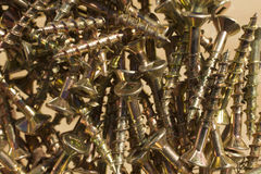 A Few Loose Screws. Closeup of gold colored screws Royalty Free Stock Photos