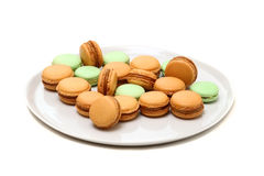 A few macaroons on the dish are  on white. Macaroons - is the most popular French dessert Stock Photos