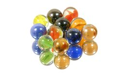 Few Marbles on Mirror. Few Isolated Marbles on Mirror Stock Photography