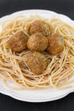 Few meatballs with spaghetti in plate Royalty Free Stock Photography