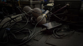 Few microphones in sound studio with wires Royalty Free Stock Photo