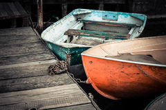 A few old boats on the dock Royalty Free Stock Photo