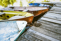 A few old boats on the dock Stock Photo