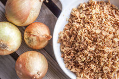 Few onions and dry onion flakes Stock Photo