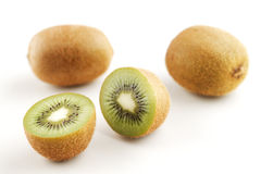 A few organic kiwi fruits Royalty Free Stock Photos