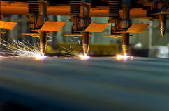 A few OxyTorches. A few oxygen torches are cutting sheet metal, a part of CNC machine Royalty Free Stock Image