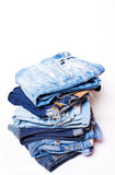 A few pairs of blue jeans Royalty Free Stock Photos
