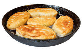 Few patties in frying pan isolated on white Stock Photos