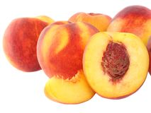 A few peaches with slice of one,on white.Isolated Royalty Free Stock Images