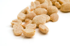 A Few Peanuts. On white background - selective focus on the foreground Stock Photo