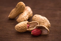 Few peanuts. On dark background Stock Photo