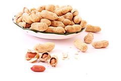 Few peanuts and dish isolated Royalty Free Stock Images