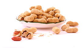 Few peanuts and dish isolated Royalty Free Stock Image