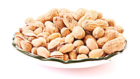 Few peanuts and dish isolated Royalty Free Stock Photo